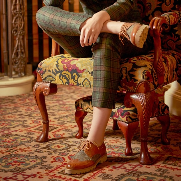 Our twist on the traditional Brogue uses Buffalo Leather with Harris Tweed.